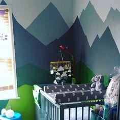 How gorgeous is this modern mountain mural in the nursery?!  via @thecraftylass!