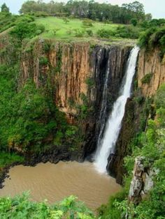 "Howick Falls is a waterfall in Howick, KwaZulu-Natal Province, South Africa. The waterfall is approximately 95 m in height feet) and lies on the Umgeni River. The Zulu people called the falls KwaNogqaza, which means ""Place of the Tall One"". Great Places, Beautiful Places, Places To Visit, Midland Meander, Local Legends, Namibia, Les Cascades, Kwazulu Natal, Out Of Africa"