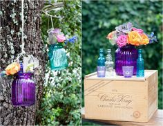 Colored glass vases, bottles and sweet flowers