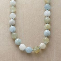 """Faceted globes of aquamarine display a world's worth of aquatic hues. Our exclusive necklace is hand knotted on silk with amazonite at the sterling silver lobster clasp. Made in USA. Approx. 18""""L."""