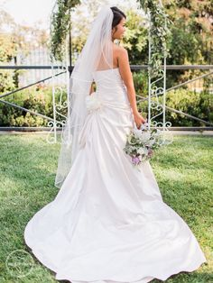 Our Bride! Find this wedding dress at Janene's Bridal Boutique located in Alameda, Ca. Contact us at (510)217-8076 or email us info@janenesbridal.com for more information.