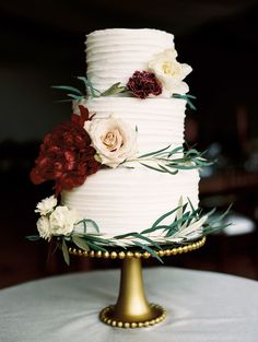 These three tiers heldItalian cream, tiramisu, and a champagne-and-raspberry flavors.Missy Vonderheide, a retired cake maker and family friend of the couple, made the red-and-green accented dessert.