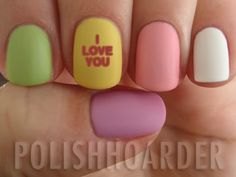 Conversation Heart valentine nails...I think I'd go with the cheesier messages, kiss me or whatnot.