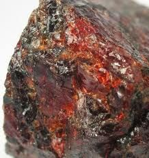 Calderite is a mineral in the garnet group with the chemical formula (Mn2+, Ca)3(Fe3+, Al)2(SiO4)3. It is dark reddish brown to dark yellowish in color and generally granular massive in form.Mohs scale hardness	6.5-7.5. It was named for geologist James Calder who worked on the geology of India.