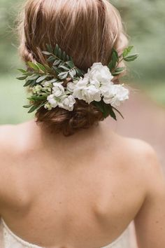 bridal hair inspiration | wedding hair | flower comb | low bun |