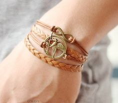 Multilayer bracelet with bronze infinity and Mockingjay charms made in vintage style. Stylish and unusual bracelet will not leave indifferent glances of passers-by. In it, you'll look chic and very im