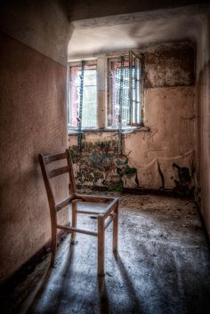 Photo of an old asylum, pretty yet in a very macabre way