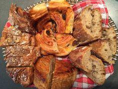 Almond croissant, traditional baguette, pain au raisin and a chausson aux pommes
