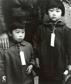 Two Japanese American children in Hayward await relocation.  May 8, 1942.  Dorothea Lange, photographer.
