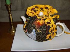 "I love hot tea, and love to use my tea pots. Keeping it warm enough to enjoy an entire potful before it gets cold can be a challenge. So, I designed a ""tea. Hobbies And Crafts, Diy And Crafts, Nifty Crafts, Teapot Crafts, Tea Cosy Pattern, Alcohol Ink Crafts, Craft Stalls, Easy Sewing Projects, Sewing Ideas"