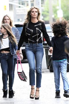 Heidi Klum wearing Amo Babe High Rise Crop Jeans in Dive Bar Destroy and Valentino Patent Leather Platform Sandals
