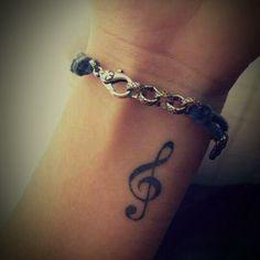 treble clef wrist tattoo