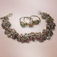 Shaggy loop chainmaille bracelet ( anodized alum.  and seed beads) with matching hand wrapped rings.