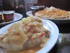 Waffles and a fried chicken thigh smothered in gravy and onions.   Yelp