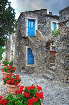 Colletta di Castelbianco, Italy. This ancient village is entirely built of stone and is believed to have been established as a defense against the Saracens in the 13th century. Some of the houses have red or blue doors which makes the town ever more charm