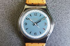 Swatch Ascot GX117 1990 Fall winter collection Standard Gents 34mm, Elegant Watch, Swatch Watches   1990 Vintage Swatch Watch Ascot GX117.  Leather band.  Diameter case 33 mm.  Water resistant 30 meter / 100 Feet.  New, never worn.   Condition: 99% NEW, Never Worn This watch is Part of a 200 Swtach Collection! Unique & Rare Models Check my other Swatch section for more models:  https://www.etsy.com/shop/InstaAntiques?ref=l2-shopheader-name&section_id=20319988