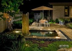 Lovely garden with trickling water feature... I'd love to have a desert and coffee at the table... tranquility.