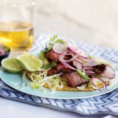 Grilled T-Bone Tostadas with Spicy Radish Salad | Make mini versions of this tostada using tortilla chips, or skip the tostada and roll the steak and salad in soft corn or flour tortillas.