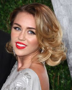 Miley Cyrus' wavy blonde highlights.     For Bev Drummond.  I would love this hair cut on you.