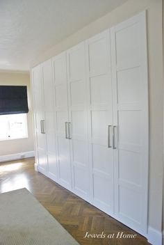 Ikea Pax wardrobes used as built-in closets.  / Master Bedroom + Guest Bedroom - change handles