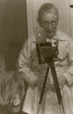 """Medium Ada Emma Deane, photographed by someone else, *still* has a spirit show up on film. Skeptics noticed that Deane required photographic plates be given to her in advance so that she could """"pre-magnetise"""" them with her psychic powers, giving her the opportunity to tamper with them. Her defenders ( includeding Sir Arthur Conan Doyle) insisted that no trickery was involved. They argued that she was merely a simple cleaning lady who lacked the expertise to pull off such deception."""
