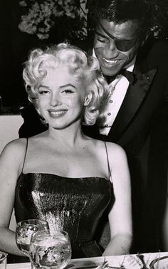 Marilyn with Sammy Davis Jr. at the Friars Club Testimonial Dinner. Photo by Bill Mark, March 11th 1955.