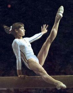 This is Nadia Comaneci, the first gymnast to get a perfect score of 10 in the olympics. She is Romanian Gymnastics History, Gymnastics Academy, Artistic Gymnastics, Olympic Gymnastics, Olympic Sports, Olympic Games, Nadia Comaneci Perfect 10, Famous Gymnasts, Gymnastics Pictures