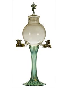 This glass Absinthe fountain is pretty special because of its decorated Fairy lid and its greenish coloring.