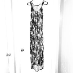 """Black and white high lo maxi dress Only worn once. Black and white, high lo  summer maxi dress. 51.5"""" from top of the strap to the bottom of the front, 57"""" from the top of the strap to the bottom of the back. Dex Dresses Maxi"""