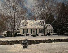 white cape cod house in winter