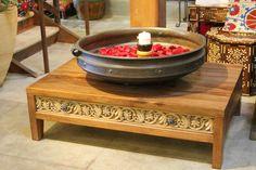 Custom designed carved coffee table!!! Antique brass urli with rose petals www.de-cor.com