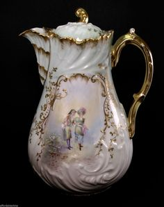 Up for sale is a gorgeous 9 1/2 tall hand painted Elite Limoges porcelain coffee pot. It is in excellent condition. Please see all pictures for complete details. General Helpful Information: ** Hand