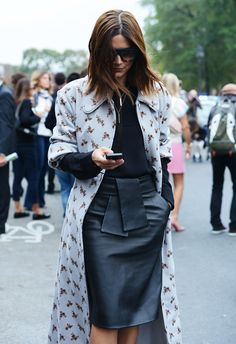 Christine Centenera in black top & short leather skirt with  louis vuitton floral print coat #Fashion Week Street Style