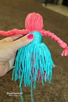 Yarn Dolls!My daughter went to an Activity Day camp for church. Not an overnighter...just 2 days of crafts and spirituality at the church. When she came home she wanted to show me what she learned to