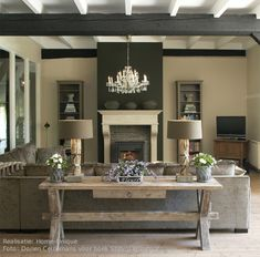 I love this look!  Love the dark accent wall on the fireplace. I was just telling David that I wish I would have done brown and gray in my livingroom...I can always change it ;-)
