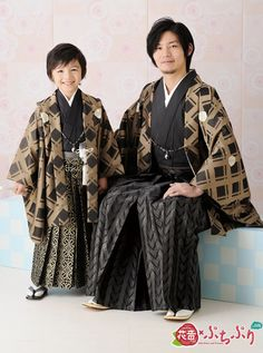 Man and boy in traditional formal kimono/hakama/haori set.  (Patterned haori and hakama make it very formal, for such occasions as shichi-go-san or graduation)
