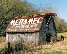 This is a Fine Art photo of a painting advertising the Meramac Caverns. These advertisements were always painted on barn roofs, to entice the curious traveler to visit the famous Meramac Caverns located in Stanton, Missouri along US 66.Throughout the Southeast one would find old barns and buildings with hand stenciled advertising about the Meramec Caverns, the world's largest single cave formation, stretching for twenty six miles of underground passage ways and caverns.