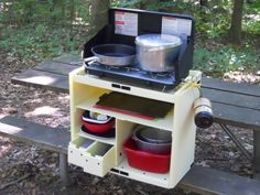 Grub/Chuck box for camping.This one looks easy enough I think I could make this. Would like to add hinged panel on top and front door that, when both are open, door supports top for extra top space - similar to older style sewing machine cabinets.