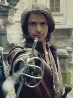 Luke pasqualino /D'artagnan a perfect casting for Eugenides. Bbc Musketeers, The Three Musketeers, Sword Hilt, Luke Pasqualino, The Garrison, Tom Burke, Brothers In Arms, Character Aesthetic, Historical Costume