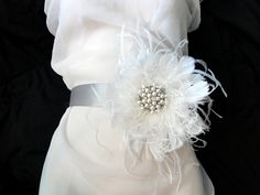 Bridal Sash, Pearl Bridal Sash, Flower Bridal Sash, Ivory Satin Bridal Belt, Ivory Feather, Rhinestone and Pearl Wedding Sash. $84.00, via Etsy.