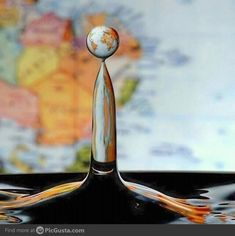 Just a waterdrop in front of a world map