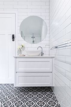 Fienza, modern vintage vanity installed by Northern Rivers Bathroom Renovations in Lismore NSW 2480. White modern traditional farmhouse bathroom. white subway tiles, laid brick bond with grey grout. Black and White patterned floor tile.