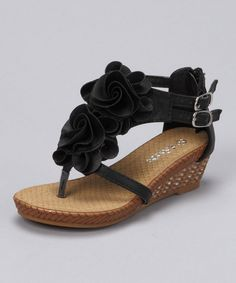 SOOOOO GETTING THIS FOR MADDY!!!!  Kids shoe: Link Black Flower Sandal by Stock The Closet: Kids' Shoes on #zulily today!