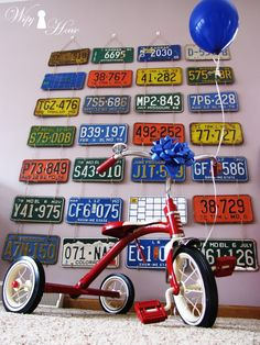 Vintage 50's car garage boy birthday party. Wall of vintage license plates as photo booth background