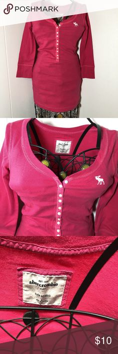 Hot pink scoop neck Abercrombie top Hot pink scoop neck Abercrombie top. Buttons down the front. Sleeves are to the elbow or forearm for girls. Size kids large. Buttons down the front are functional. Shirt has a lot of stretch. And it holds its form very well meaning it won't loosen up on you. abercrombie kids Shirts & Tops Tees - Long Sleeve
