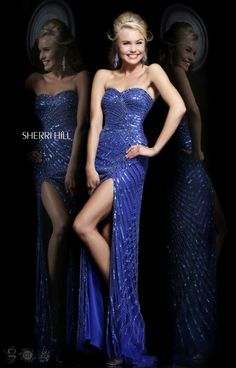 Sherri Hill 1714 is a sexy straight dress. This dress is sure to show of your best curves. The embellishments throughout the dress makes it a spot light dress. The leg baring slit allows you to show off your legs. This dress is definitely crown-worthy.