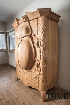 Clothes in a bug, not the other way around - Magnificent Armoire Is Shaped Like a Beetle