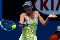 Maria Sharapova hits a forehand during her straight sets win over Olga Puchkova during the first round of the 2013 Australian Open ..!!