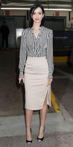 Krysten Ritter wearing a fashionable striped wrap blouse, beige pencil skirt and metallic-toe pumps