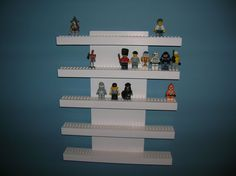My friend makes these...great LEGO product for the money! (LEGO Mini Figure Display Shelf  5 Row by JMorganCrafts on Etsy, $15.00)